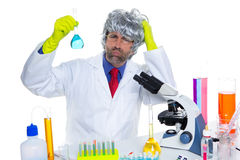 Crazy nerd scientist silly man on chemical laboratory Stock Photos