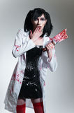 Crazy nurse with bloody knife Stock Photography