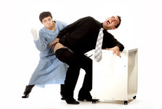 Crazy nurse giving injection to scared man Royalty Free Stock Photography