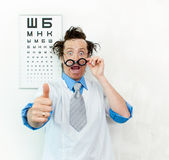 Crazy oculist Stock Image