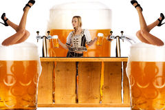 Crazy oktoberfest style with sexy tiroler girl serving beer Stock Photos
