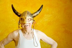 Crazy Old Man in a Viking Helmet Royalty Free Stock Photos