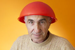 Crazy old man wearing red bowl Royalty Free Stock Photography