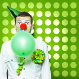 Crazy Party Clown Inflating Green Party Balloon Stock Image
