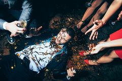 Crazy party. Drunk man lying on floor Royalty Free Stock Photo