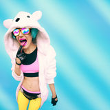 Crazy party girl in hoodie bear on a blue background. positives Stock Images