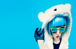 Crazy party girl in hoodie bear on a blue background. positives. Emotions Stock Photography