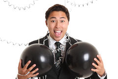 Crazy party guy with balloons. Wearing a suit and tie. White background Stock Images