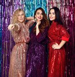 Crazy party time of three beautiful stylish women in elegant outfit celebrating new year, birthday , having fun, dancing royalty free stock photo