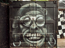 Crazy pilot portrait graffiti on rusty metal surface of garage Royalty Free Stock Photo