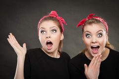 Crazy pin up retro girls making funny faces. Royalty Free Stock Photos