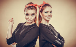Crazy pin up retro girls making funny faces. Stock Photography
