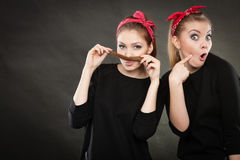 Crazy pin up retro girls making funny faces. Stock Images