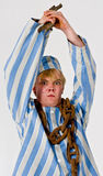 Crazy prisoner. A theatrical actor in the role of a crazy prisoner stock image