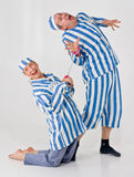 Crazy Prisoners. Two men in a studio shoot posing like crazy prisoners Stock Photography