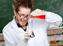 Crazy professor mixes two liquids Stock Photos