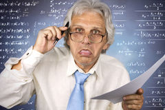 Crazy professor. Crazy old professor holding pencil and paper Royalty Free Stock Photo