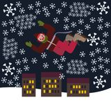 Crazy punk Christmas elf flying over the city in a snow blizzard Royalty Free Stock Image