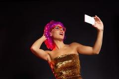 Crazy purple wig girl selfie smartphone fun glasses Royalty Free Stock Image