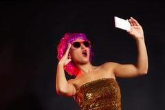 Crazy purple wig girl selfie smartphone fun glasses Royalty Free Stock Photo