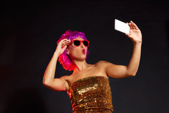 Crazy purple wig girl selfie smartphone fun glasses Stock Image