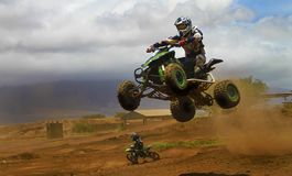 Crazy Quad. An ATV getting air with motorcycle Royalty Free Stock Image