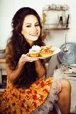 Crazy real housewife on kitchen smiling eating Royalty Free Stock Photo