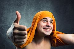 Crazy real man. Crazy real people with yellow textile on head stock photo