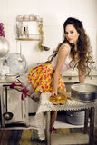 Crazy real woman housewife on kitchen, eating Stock Images