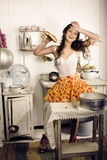 Crazy real woman housewife on kitchen, eating Royalty Free Stock Images