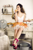 Crazy real woman housewife on kitchen, eating Royalty Free Stock Photography