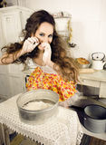 Crazy real woman housewife on kitchen, eating perfoming, bizare girl Stock Image