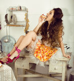 Crazy real woman housewife on kitchen, eating perfoming, bizare girl Stock Photos