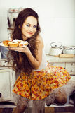 Crazy real woman housewife on kitchen, eating perfoming, bizare. Girl celebrating womans day Royalty Free Stock Photo