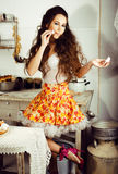 Crazy real woman housewife on kitchen, eating perfoming, bizare Stock Photography