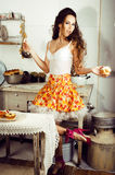 Crazy real woman housewife on kitchen, eating perfoming, bizare Royalty Free Stock Image
