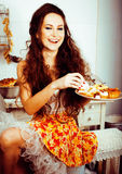 Crazy real woman housewife on kitchen, eating perfoming, bizare Stock Images