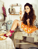 Crazy real woman housewife on kitchen, eating perfoming, bizare Stock Photo