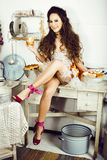 Crazy real woman housewife on kitchen, eating perfoming, bizare. Girl celebrating womans day Stock Photography