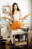 Crazy real woman housewife on kitchen, eating perfoming, bizare. Girl celebrating womans day Royalty Free Stock Images