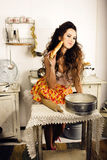 Crazy real woman housewife on kitchen, eating perfoming, bizare. Girl celebrating womans day Royalty Free Stock Photography
