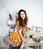 Crazy real woman housewife on kitchen, eating perfoming, bizare. Girl celebrating womans day Royalty Free Stock Image