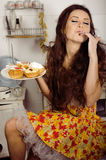 Crazy real woman housewife on kitchen, eating perfoming, bizare girl. Halloween dress Stock Images