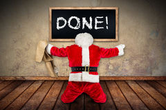 Crazy red white santa claus job done blackboard room. Funny crazy hilarious red white santa claus celebration clench fist holding bag in the air job done stock image