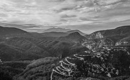 Crazy road with mountains on background in black and white. NZagori,Zagorochoria Greece Europe Royalty Free Stock Images