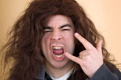 Crazy Rocker Dude. A rocker dude goes wild and starts head banging Stock Photos