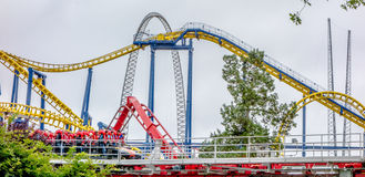 Crazy rollercoaster rides at amusement park Royalty Free Stock Photography