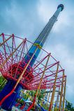 Crazy rollercoaster rides at amusement park Royalty Free Stock Photos