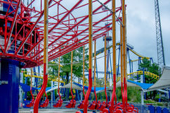 Crazy rollercoaster rides at amusement park Stock Photos