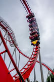 Crazy rollercoaster rides at amusement park Stock Images